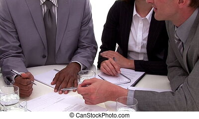 Close-up of business people having a brainstorming against a...