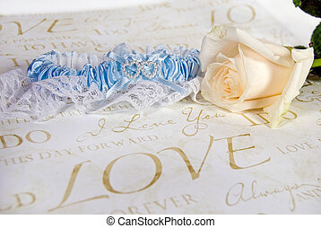 Something Blue - White rose with bridal garter on wedding...