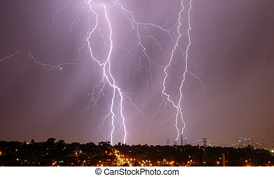 Lightning over city skyline - Lightning strikes over...