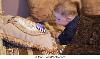 little boy watching cartoon
