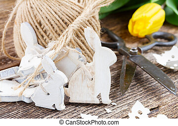 easter decorations with yellow tulips - easter bunnies with...
