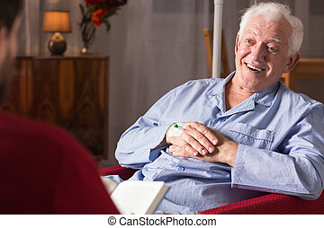 Care giver assisting senior man - Horizontal view of patient...