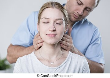 Woman havinh her neck massaged - Woman having her neck...