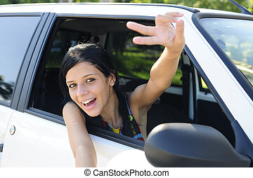 new car: teenage girl showing victory sign