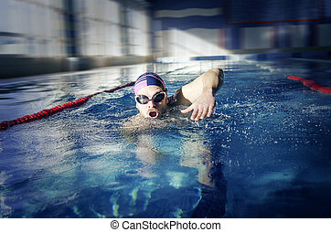 Swimmer swims in the pool. - Swimmer. Man swims in the pool...
