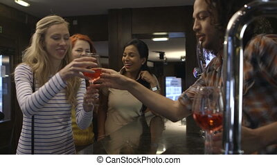 Lets toast to this! - Three women ordering glasses of red...