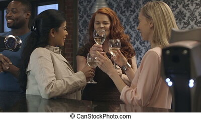 Let's toast to this! - Three women at a bar toasting their...