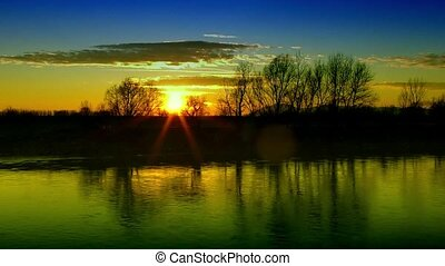 Sunset Behind the River Timelapse - Beautiful sunset behind...