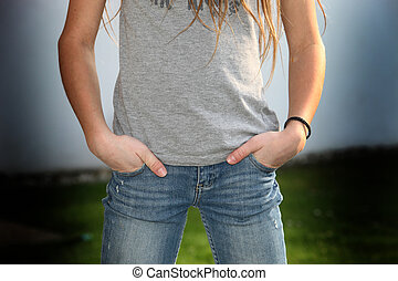 A girl in puberty - she has the hand in the bag