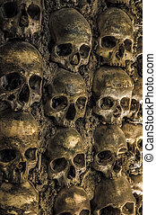 Wall full of skulls and bones.