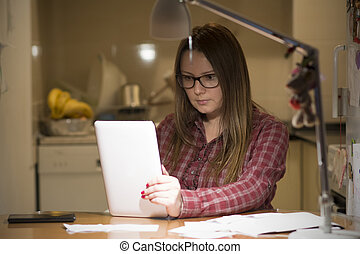 Housewife paying bills online