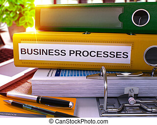 Business Processes on Yellow Office Folder Toned Image -...