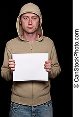 male in a hoodie holding blank advert space