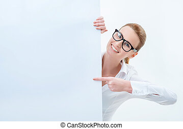 Vivacious woman looking out of white board - Just have a...