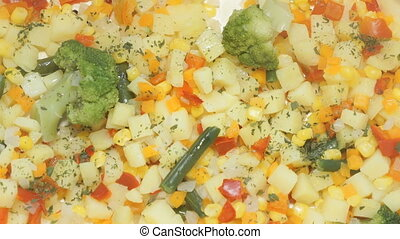 Various vegetables are cooked in the electric white double...