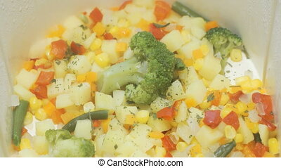 Various vegetables are cooked in the electric white double boiler
