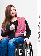 Woman invalid girl on wheelchair using tablet - Real people,...