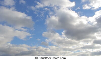Flying white clouds in the blue sky,