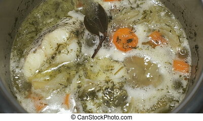 Cooking the Macrourus fish soup. Fish soup is cooked