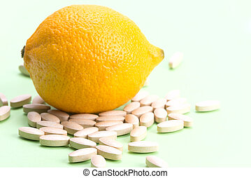 medical pills with vitamin C and lemon