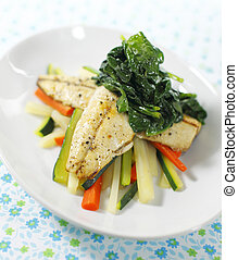 cooked mackerel fish meal with spinach on the top. Carrot...