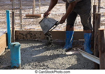 Concrete pouring during commercial concreting floors of...