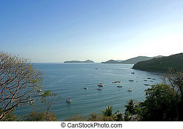 Phuket On the sky is clear - boat at sea, and one corner of...