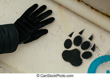 Footprint of an animal painted on metal construction and...