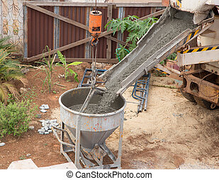 mixed concrete pouring at the construction site
