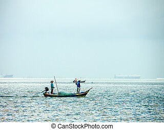 Two fisherman on boat