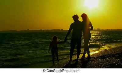 Young family fun on the beach
