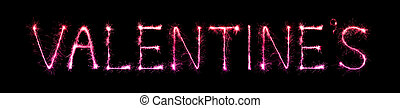 Valentine's Day text written with Sparkling Fireworks over...