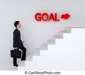 Business man stepping up on stairs to goal