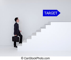 Business man stepping up on stairs to target - Business man...