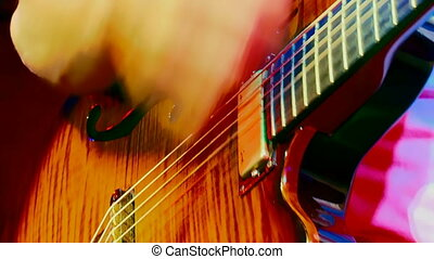 Music - Close-up. Mastery of guitar playing.