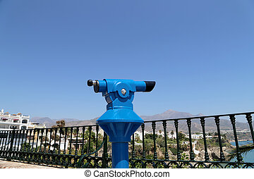 Telescope viewer overlooking from Balcon de Europa in Nerja,...