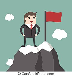 Businessman on mountain summit