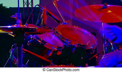 Drumming - Colorful. Man plays the drums.