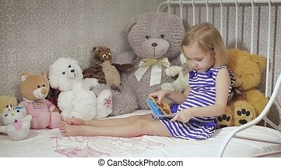 Cute kid girl playing with toy at home. Crib