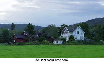 """White nights at midnight, village near Oslo, Norway,..."
