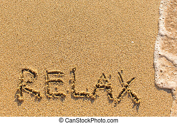 Relax - word drawn on the  beach