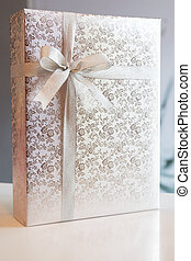 Gift box tied with a bow.