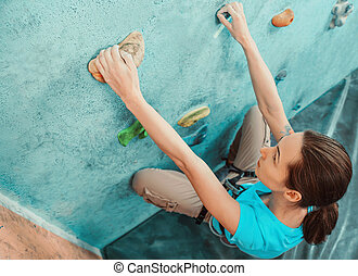 Starting bouldering track - Climber young woman starting...