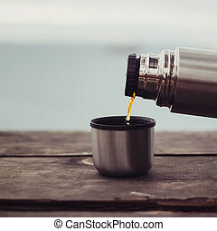 Pouring tea from thermos outdoor - Pouring tea to cup from...