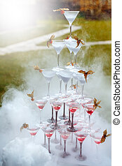 Pyramid of Champagne Glasses with Dry Ice Vapor