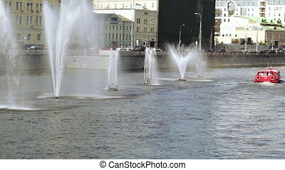 Fountains and boat on river - In Moscow River boat goes past...