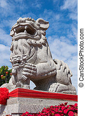 Stone lion statue in chinese temple.