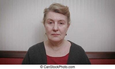 Elderly women and feelings, portrait of serious senior...