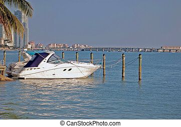 Cabin Cruiser - Small cabin cruiser moored at a condo marina...