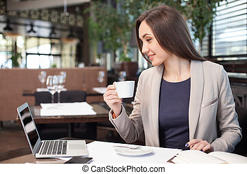 Cute young businesswoman is resting in restaurant - Cheerful...